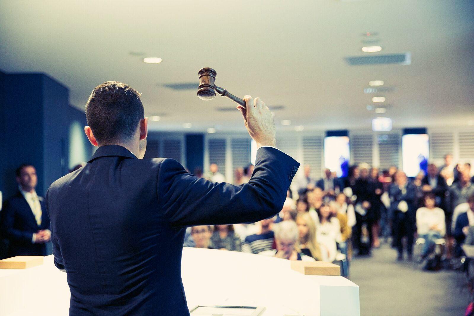 Damien auction room